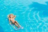 Woman relaxing at the swimming pool — Stock Photo