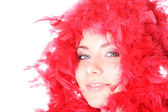 Beautiful woman with red fan — Stock Photo