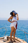 Young woman on her private yacht — Stock Photo