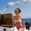 Young woman driving a speedboat — Stock Photo #29298263