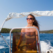 Stock Photo: Young woman driving a speedboat