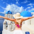Woman enjoying the view of Santorini — Stock Photo #29298673
