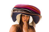 Woman with many summer beach hats — Stock Photo