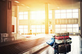 Suitcases on a cart at the airport — Stock Photo