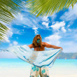 Stock Photo: Womwith sarong on beach