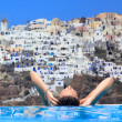 Woman enjoying the view of Santorini — Stock Photo