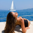 Young woman on her private yacht — Stock Photo #30375533