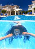 Woman diving underwater — Stock Photo