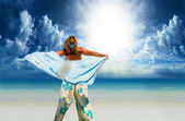 Woman with sarong on the beach — Stock Photo