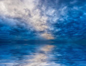 Skyscape with water reflections — Stock Photo