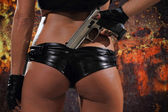 Sexy woman with gun — Stok fotoğraf