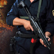 Special tactics man holding a weapon — Photo