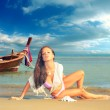 Beautiful woman on the beach with long tail boat — Stock Photo