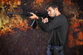 Special tactics man holding a weapon — Stock Photo