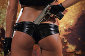 Sexy woman with gun — Stockfoto