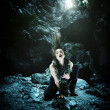 Woman with dragon in a cave — Foto de Stock