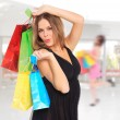 Young woman holding shopping bags  — Foto Stock