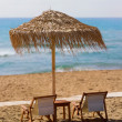 Chair and umbrella on the beach in Corfu — Stock Photo
