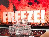 Ice cubes on computer keyboard — Stockfoto