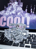 Ice cubes on computer keyboard — Stock Photo