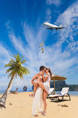 Couple on the beach at tropical resort Travel concept — Stock Photo