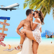 Couple on the beach at tropical resort — Stockfoto