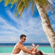 Couple on the tropical beach — Stock Photo