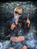 Beautiful sexy girl with gun — Stock Photo