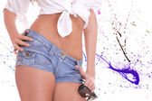Young woman in blue jeans shorts — Stock Photo