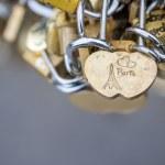 Love locks in Paris bridge symbol of friendship and romance — Stock Photo #36864749