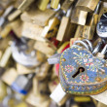 Love locks in Paris bridge symbol of friendship and romance — Stock Photo #36872863
