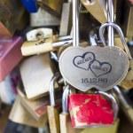 Love locks in Paris bridge symbol of friendship and romance — Stock Photo #36872881