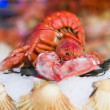 Fresh seafood in fish market — Stock Photo #36872897
