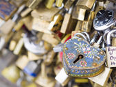 Love locks in Paris bridge symbol of friendship and romance — Stock Photo