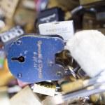 Love locks in Paris bridge symbol of friendship and romance — Stock Photo #36963293