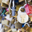 Love locks in Paris bridge symbol of friendship and romance — Photo
