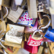 Stock Photo: Love locks in Paris bridge symbol of friendship and romance