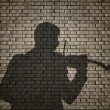 Silhouette of a violin player on brick wall — Stock Photo