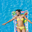 Stock Photo: Girl is relaxing in swimming pool