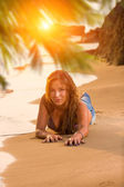 Woman in blue jeans and bikini at the beach — Stock Photo