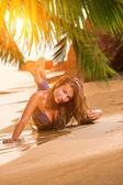 Woman in blue jeans and bikini at the beach — Zdjęcie stockowe