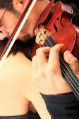 Beautiful lady with handsome man with violin — Stock Photo