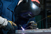 Worker with mask welding metal — Stock Photo