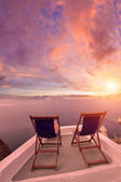 Sunbeds on Santorini — Stock Photo