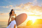 Asian woman with surfboard on the beach — Stock Photo