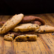 Stack of Chocolate chip cookies on wooden background. — Photo