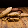 Stack of Chocolate chip cookies on wooden background. — Stock fotografie