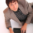 Stock Photo: Attractive businessmwith netbook