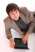 Attractive businessman with a netbook — Stock Photo
