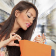 Young woman holding shopping bags — Stock Photo #40522821